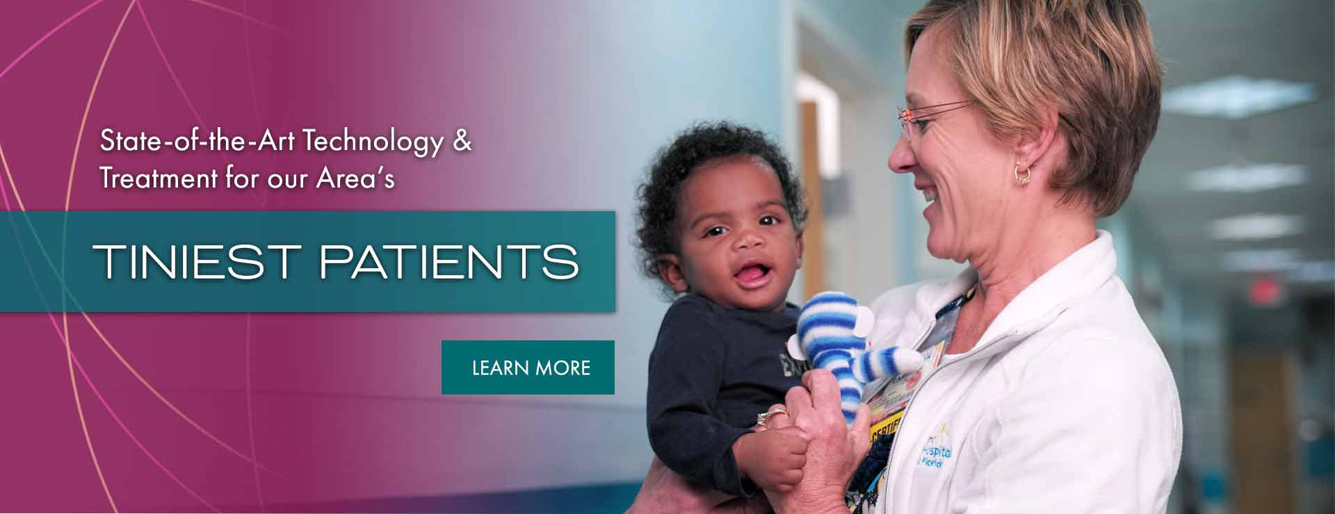 SWFL Children's Charity Doctor holding Baby Boy by Priority Marketing