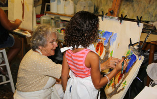 SWFL Children's Charity Child Artist with Owl Painting by Priority Marketing